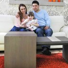 red shag rug and family in living room